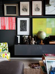 small space secrets go long and low with a console dark walls