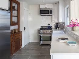 tile floor stainless steel appliances white walls small kitchen