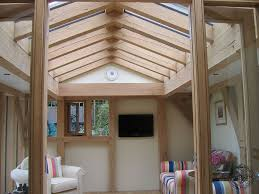 green oak timber frame and glass conservatory extension with roof