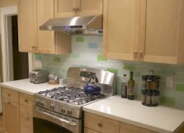interior dark stained cabinets white subway tiles and on