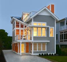 orange house exterior beach style with cable railing traditional