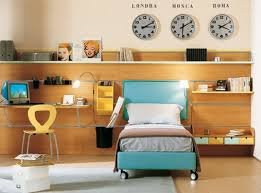 simple kids bedroom with wood wall ornament blue headboard desk