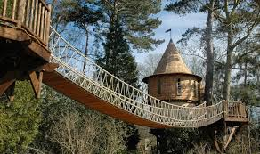 Tree Houses Around The World This Family Lives In A Tree House That Looks Like A Castle Wait