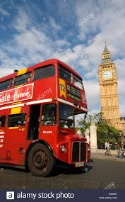 red double decker bus with big ben behind in london routemaster