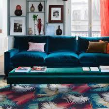 canape turquoise un grand canapé bleu turquoise et une banquette bleu canard avec une