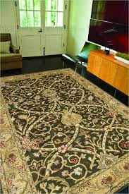 brown and tan area rug jaipur poeme biarritz hand tufted arts and craft pattern wool