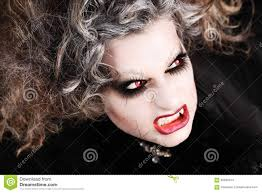 vampire woman portrait with mouth showing teeth canines halloween