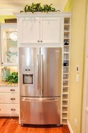 custom wine rack above fridge instead of a useless cabinet u2013 ask