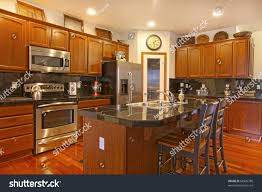 kitchen dark golden cherry cabinets matching stock photo 68920780