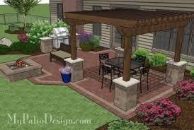 backyard brick patio design with 12 x 12 pergola grill station