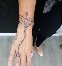 tattoo bracelet wrist images 19 bracelet tattoos that you need to see now png