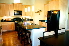 Kitchen Colors With Oak Cabinets And Black Countertops by Kitchen With Dark Cabinets Light Countertops Dzqxh Com