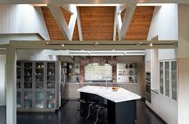 panelled walls light wood floors with dark cabinets kitchen contemporary with