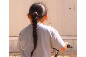 hairstyle with 2 shoulder braids dress code flare up native american kindergartner sent home for