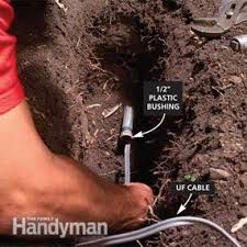 how to put lights on a tree outdoors how to install outdoor lighting and outlet family handyman
