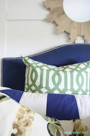 guest bedroom with a blue headboard life on virginia street