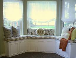 grey cream fabric striped window seat connected by mocha pillows