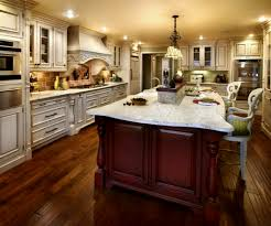 marble countertops cherry wood kitchen island lighting flooring