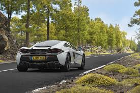 off road sports car watch two mclaren 570gt supercars go off road and own the night