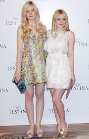 how old is dakota fanning elle fanning 14 towers over 18 year old dakota at south korea