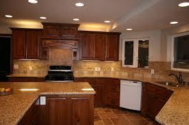granite countertop dark and light kitchen cabinets rock tile