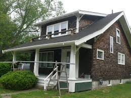 installation of a new wood gutter on a c1920 craftsman stye