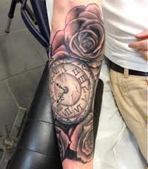 rose flowers and clock tattoo on man right sleeve