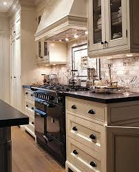 what color cabinets go with black appliances kitchen black and white kitchen marble subway tile back splash