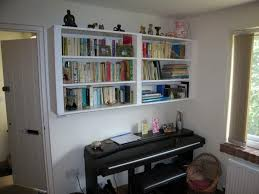 wall mounted design bookshelves ideas what about suspending these
