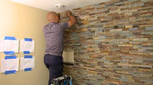 stone tile accent wall in bathroom video hgtv