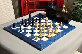 the grandmaster chess set and board combination blue gilded