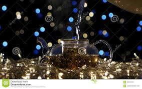 boiling water pour in teapot with tea leaves flickering lights