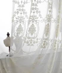 a pair of white sheer curtains made to order upto 104