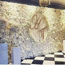 wedding backdrop flower wall we never tire of seeing a flower wall and this magnificent design