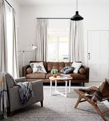 grey walls brown sofa living room with grey walls and brown couch thecreativescientist com