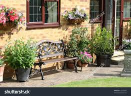 Garden Baskets Wall by English Back Garden Bench Seat Flower Stock Photo 15373834