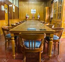 old wooden conference table with leather chairs in wooden meeting