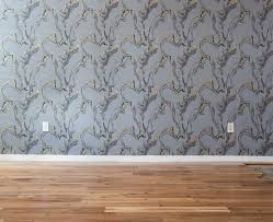 mid century modern baseboard a neutral mid century living room vignette emily henderson