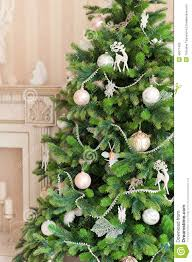 tree with white ornaments in vintage interior stock