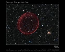 explosion shines like ornament in hubble photo