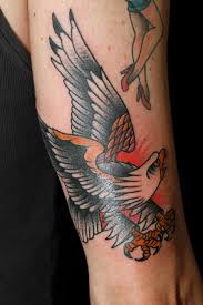 amazing traditional eagle tattoo for arm real photo pictures