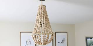 How To Make A Diy Chandelier Remodelaholic How To Make A Wood Bead Chandelier