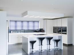 Kitchen Central Island by Matt White Doors And Silestone Worktops Compliment The Polished