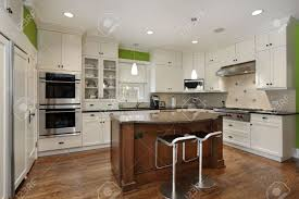 Kitchens With Island by Luxury Kitchen With Island And White Cabinetry Stock Photo