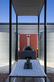 Coastal House Designs Coastal House Design With Rear Sheltered Courtyard And Wood Fired