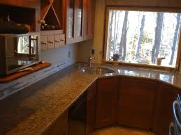hickory wood bordeaux madison door corner kitchen sink cabinet backsplash diagonal tile travertine ceramic tile countertops sink faucet island lighting