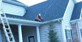 how to install christmas lights how to hang christmas lights on roof man putting lights on roof