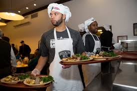 thanksgiving dinner st louis deron williams of the brooklyn nets serves thanksgiving dinner at