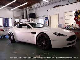 chrome aston martin aston martin vantage wrapped in satin white by dbx diamond black