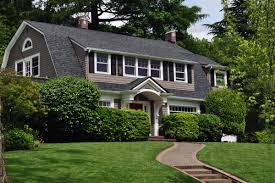 stately exterior of a gambrel with large push out for second